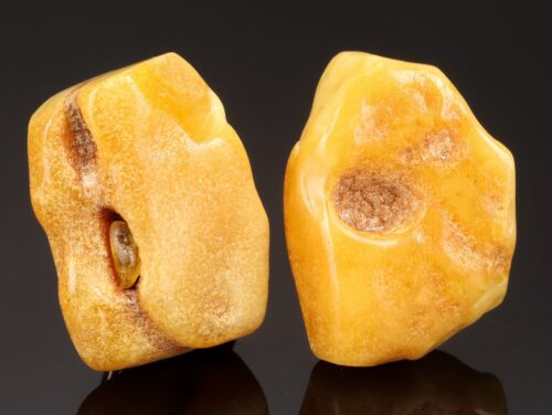 Two pairs of sterling silver ear clips of amber